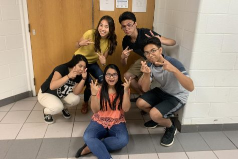 A capella club members gather for a goofy photo op in the music hallway.