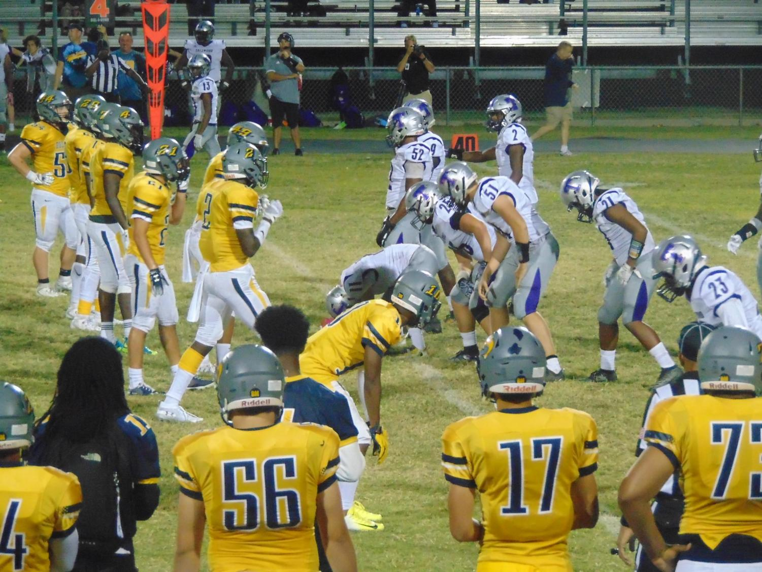 Varsity defense lines up against Tallwood at home on Sept. 27.