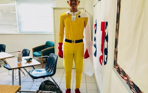 Caleb Lewis shows off colorful attire to celebrate spirit week.