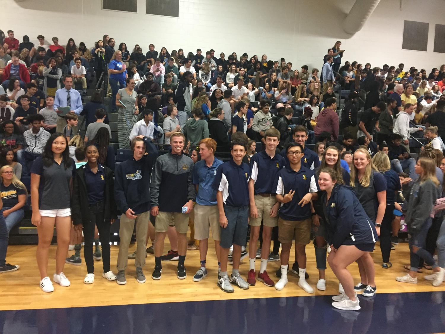 Golf team stands for recognition at fall sports assembly on Sept. 25.