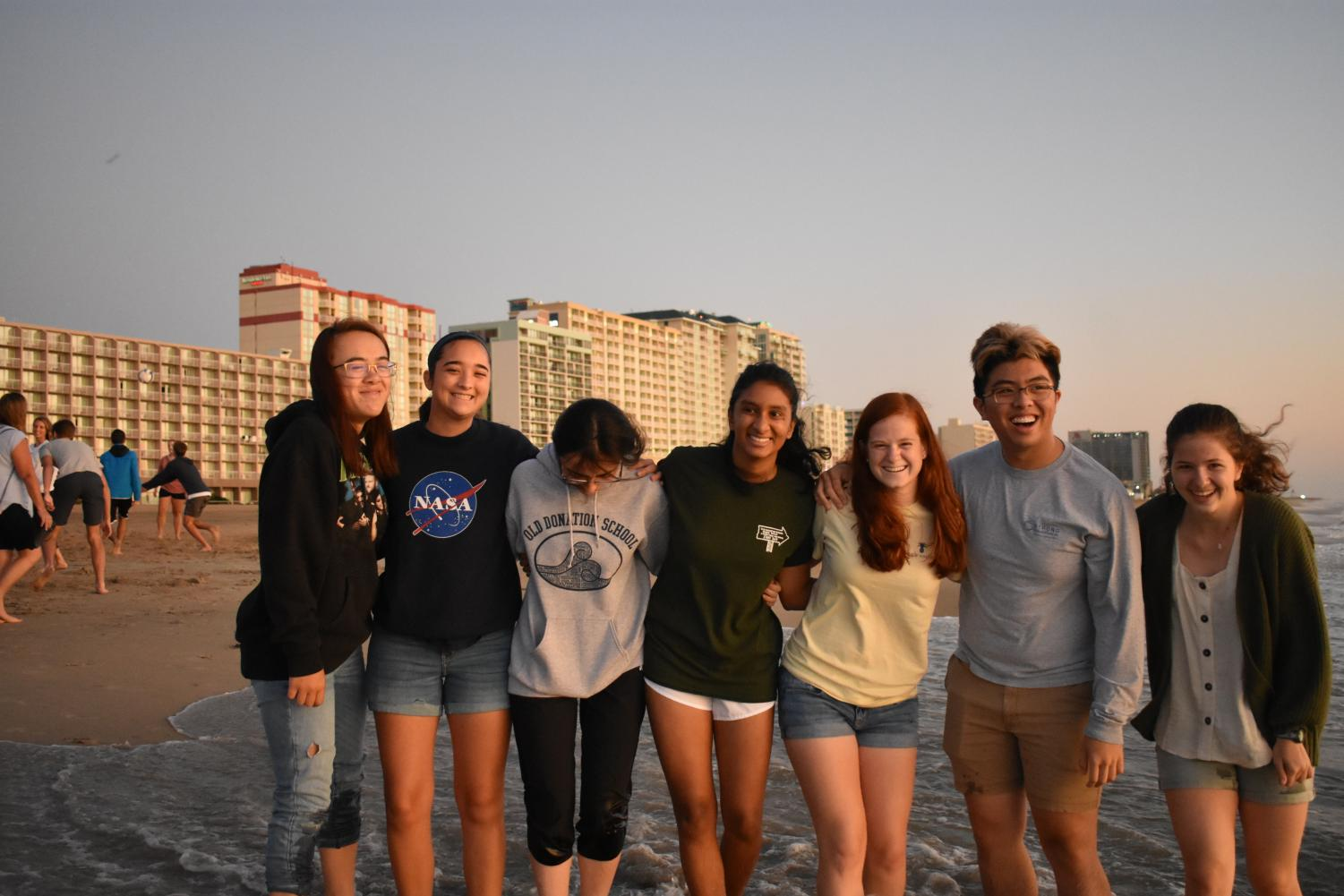A cluster of seniors group together for a picture at the oceanfront on August 30.