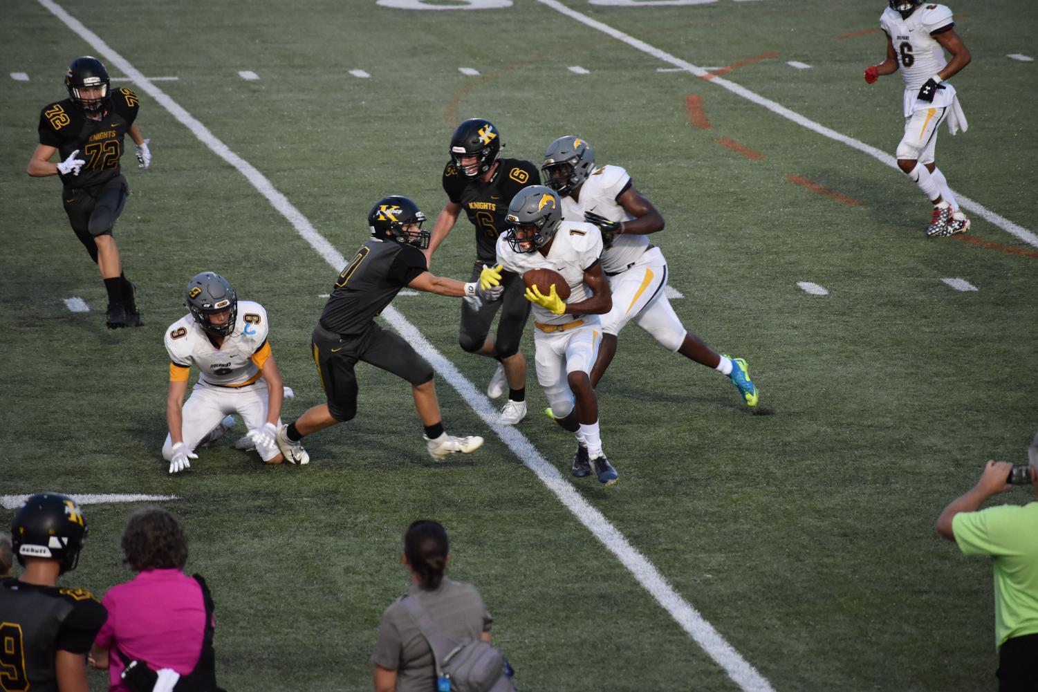 Junior Myles Alston (#1) runs past Kellam players at Kellam High School on Sept. 4.