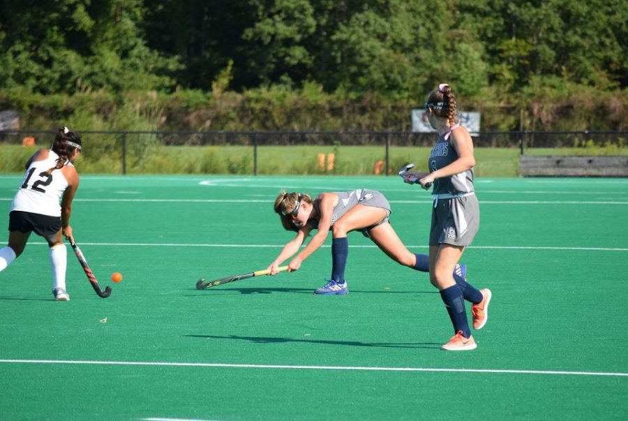 Senior+Brooke+Sullivan+lunges+for+the+ball+in+a+varsity+game+against+Kellam+at+Regional+Training+Center+on+Sept.+10%2C+2019.