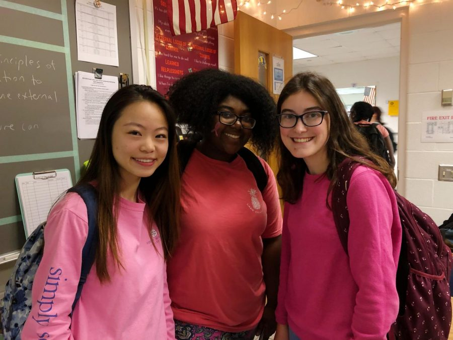Seniors, Britney Ni, Kianna Butts, and Emma Vleck, participate in spirit day on Wednesday Oct. 30, by wearing their most pretty and pink outfits.