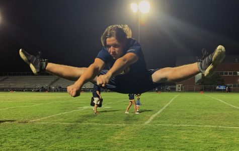 First male sideline cheerleader jumps into season