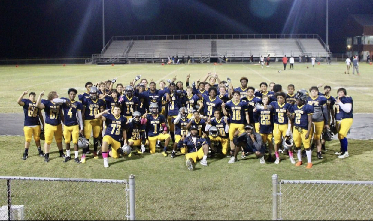 The Dolphins celebrate defeating the Bayside Marlins to finish their undefeated season.