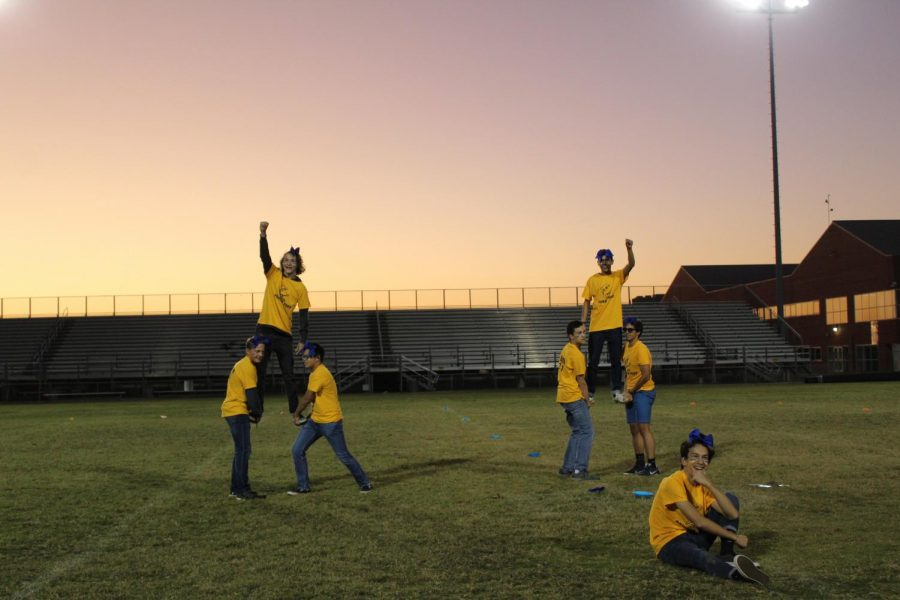 The juniors cheerleading team finish their dance strong on Oct. 23.