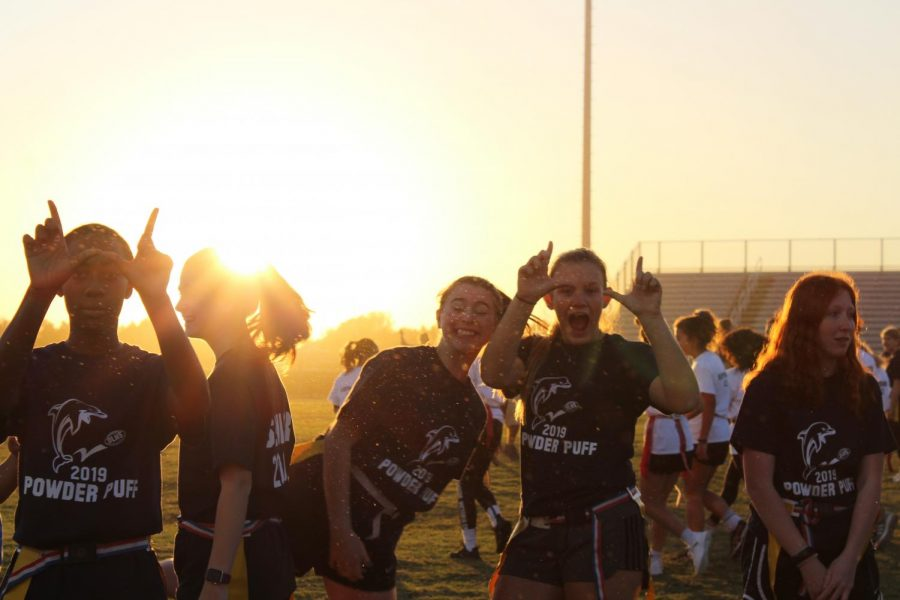 Seniors get pumped up before they play their first football game against the sophomores on Oct. 23.