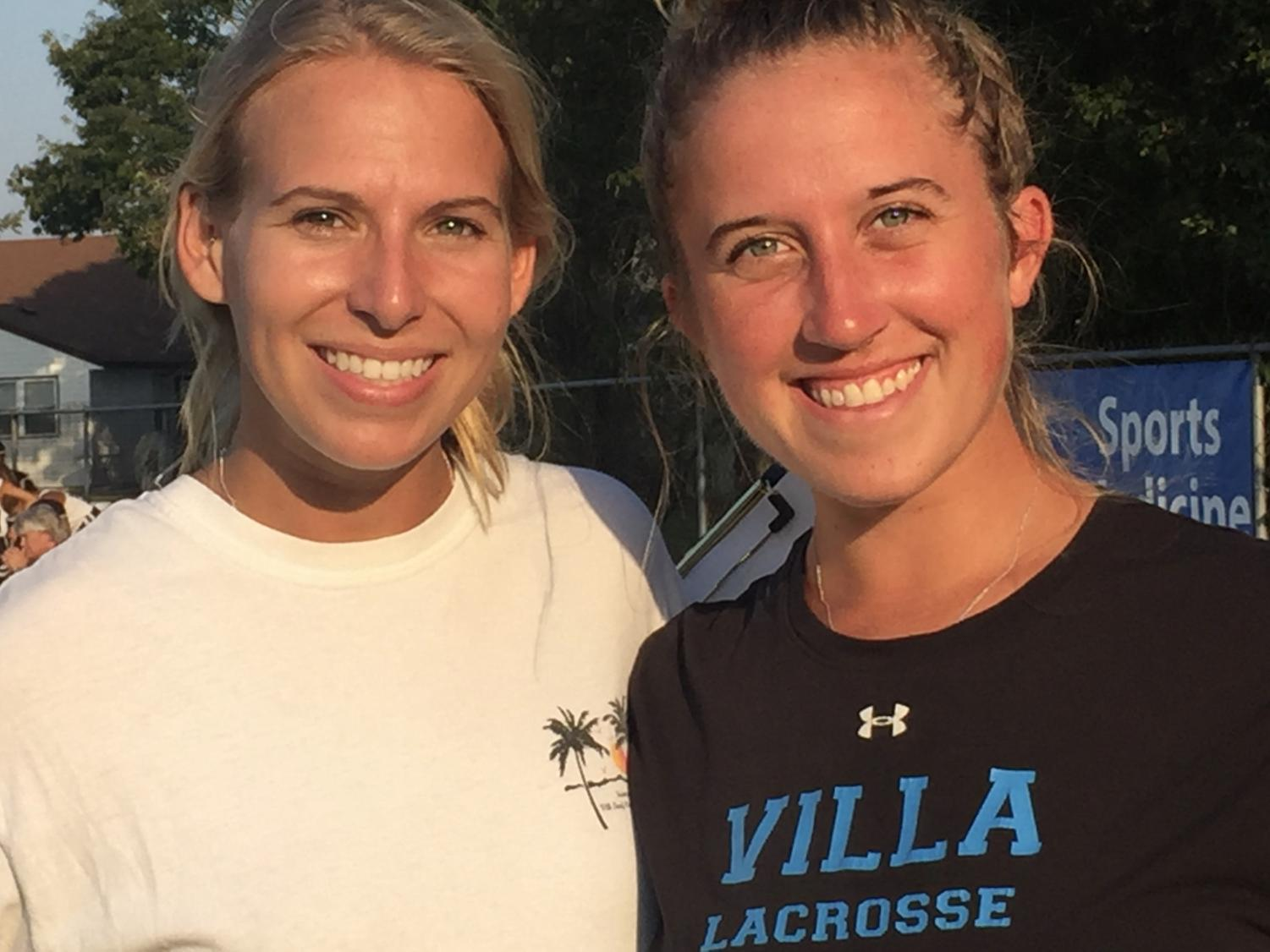 From left to right: field hockey coaches Kristen Vick and Alexandria Ostich smile after a victory at Salem High School on Oct. 3.