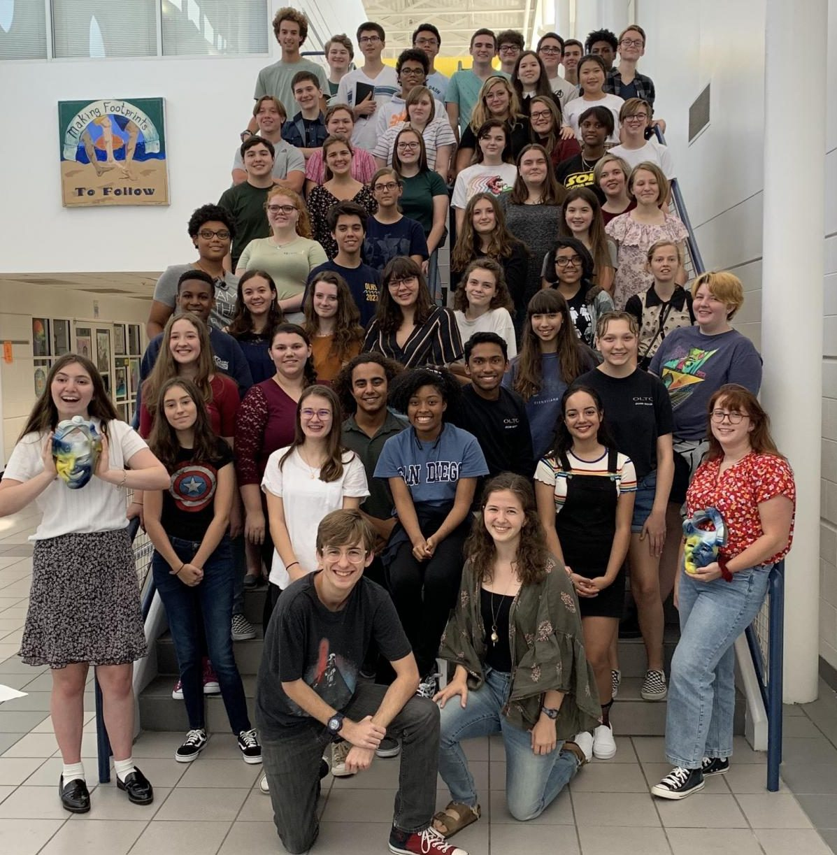 Taming of the Shrew workshop attendees pose on staircase on Oct. 23, 2019.