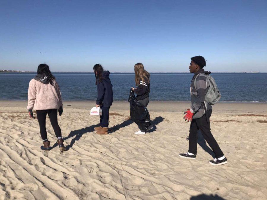 From left to right, Shreya Raj, Victoria Guerrero, Sierra Tompkins, and Miles Cooper walk the beach on November 10.
