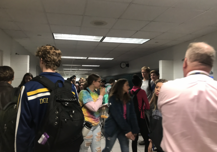 Students transition from class to class for third block.