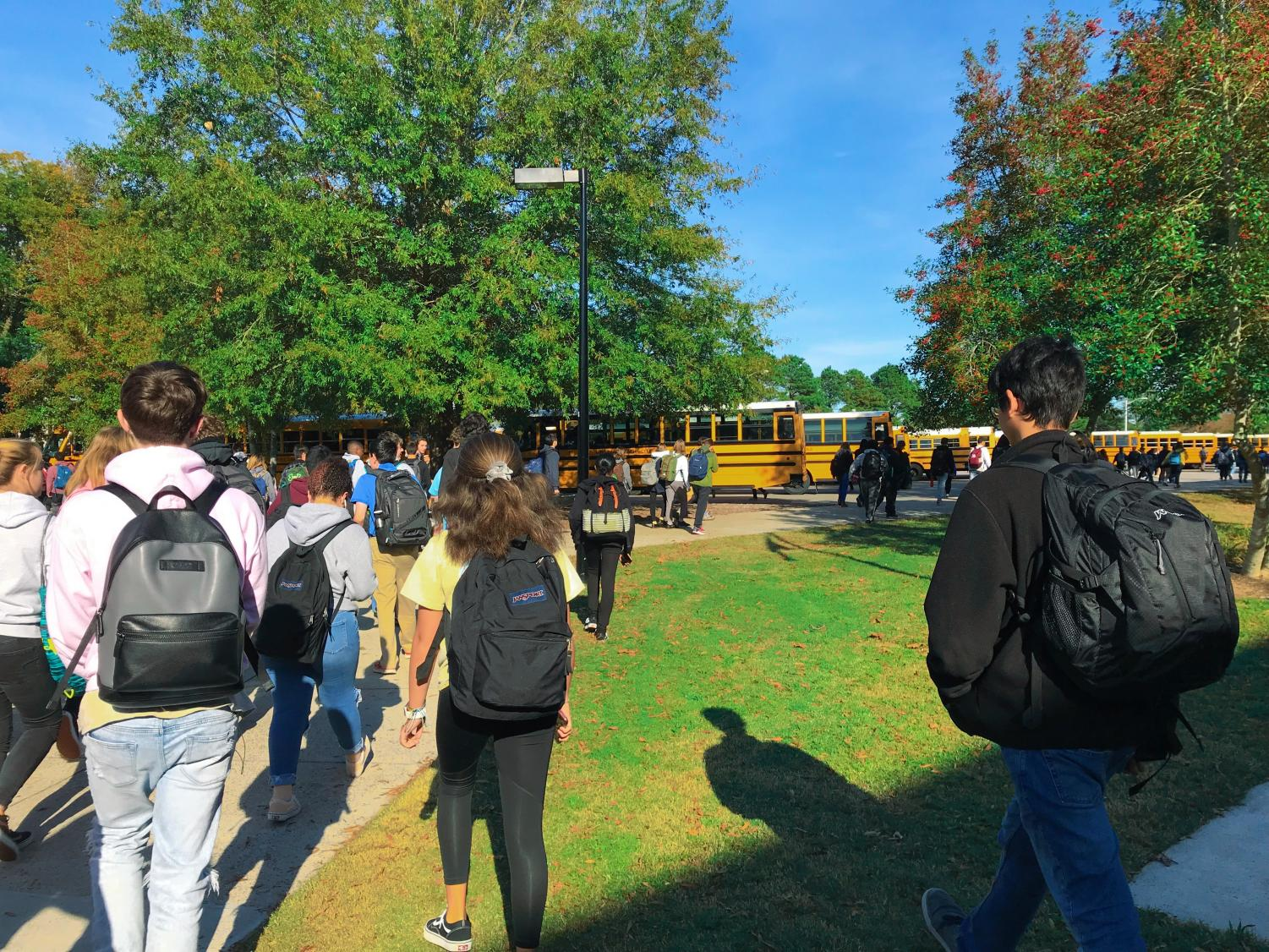 Students make their way to the buses after school at current end time, 2:10 pm.