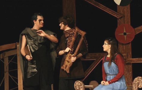 (left to right) Seniors Thomas Chick, Patrick Walker, and Liza Young rehearse the play onstage on Nov. 19.