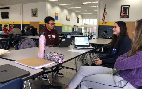 Featured on left, David Lee, and Maren Kelley on right. TARC Club discusses fin shapes on rockets using program Rocket Sim.