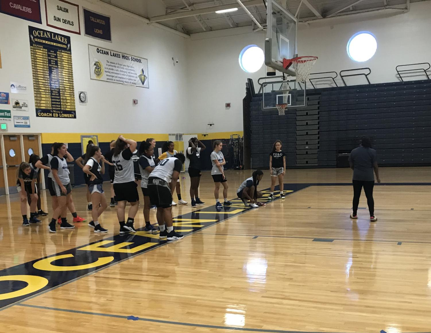 Coach Lisa Merriweather talks to the girls basketball team during practice.