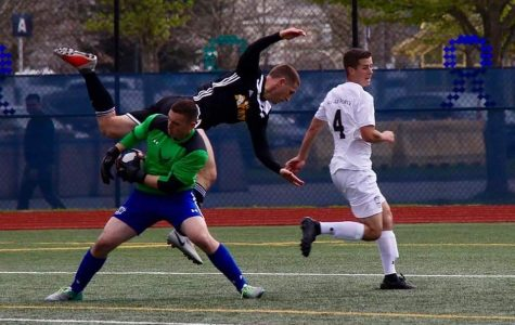 Ben Lockler, pictured in green, wins possession of the ball  in the the Air-Force vs All-Army game April 2019.
