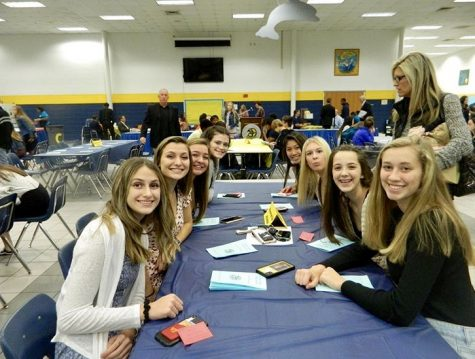 The Girls Volleyball team sits together during the banquet on November 27.
