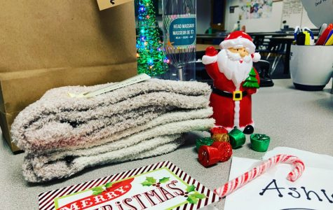 On the first day of the English Department Secret Santa, teacher Ashley Adams received her first of the five sensory gifts teacher Carol Seacrist snuck into room 145. The personal