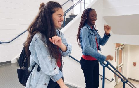 "In the stairway, sophomores Leiale Demant and Amba May-Parker dance to ""Renegade"" for a TikTok on Dec. 12. Photo by Abby Asimos."