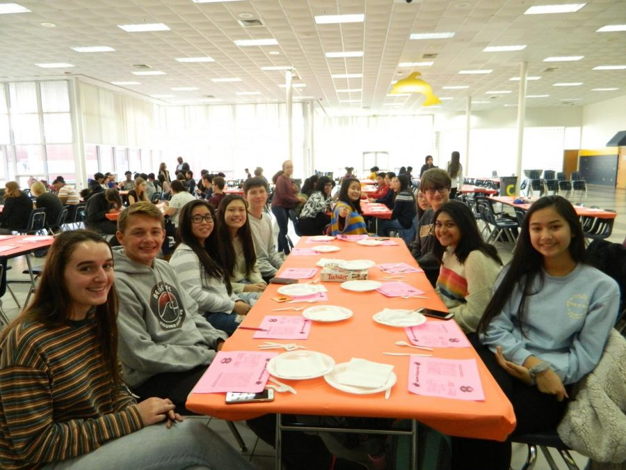 Club members prepare to eat their Finsgiving meals in the school cafeteria on Nov. 25.