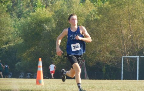 Sophomore Gabe Bowers runs in third district meet.