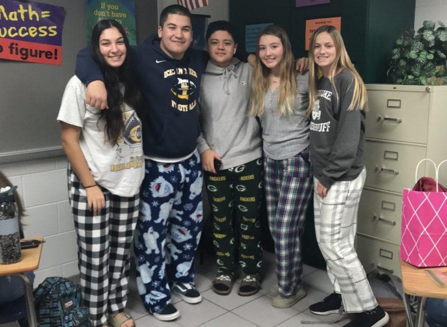 Anita Farashahi, Elijah Torres, Vincent Vuocolo, Kristen Glaser, and Megan Spillane pose in their pajama pants for the first day of spirit week on Dec. 16.