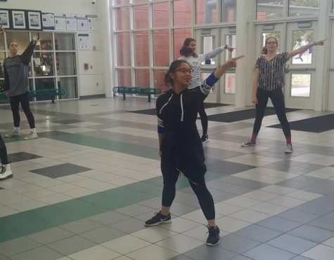 Leonyl Lazaga practices dance routine after school in the gym foyer on Dec. 12.