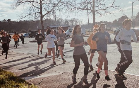 Indoor track runners Sophia Pommerank, Sophie Richardson, Cailan Juhas, Amanda Suh, and Drew Cavanaugh warm up for a short and fast sprint workout despite the chilly weather. Jan. 22, 2020.