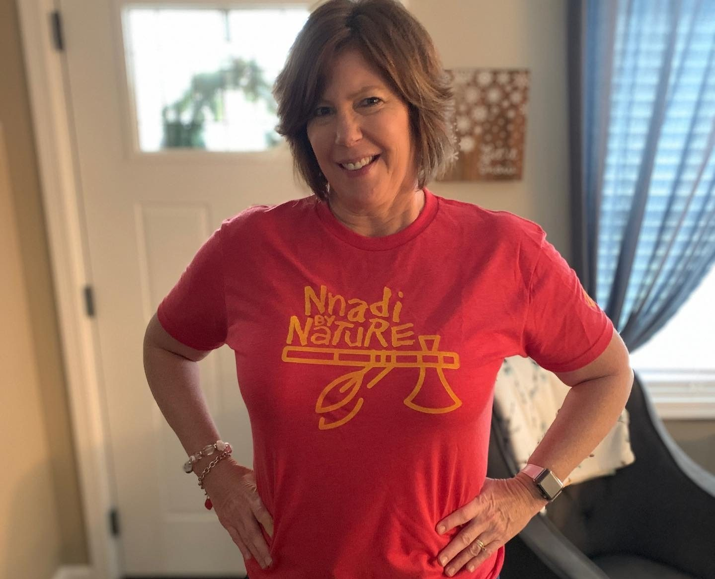 A huge fan, teacher Carol Seacrist promotes Derrick Nnadi, who is headed to the Super Bowl, by buying one of his t-shirts online and posting it on Facebook.