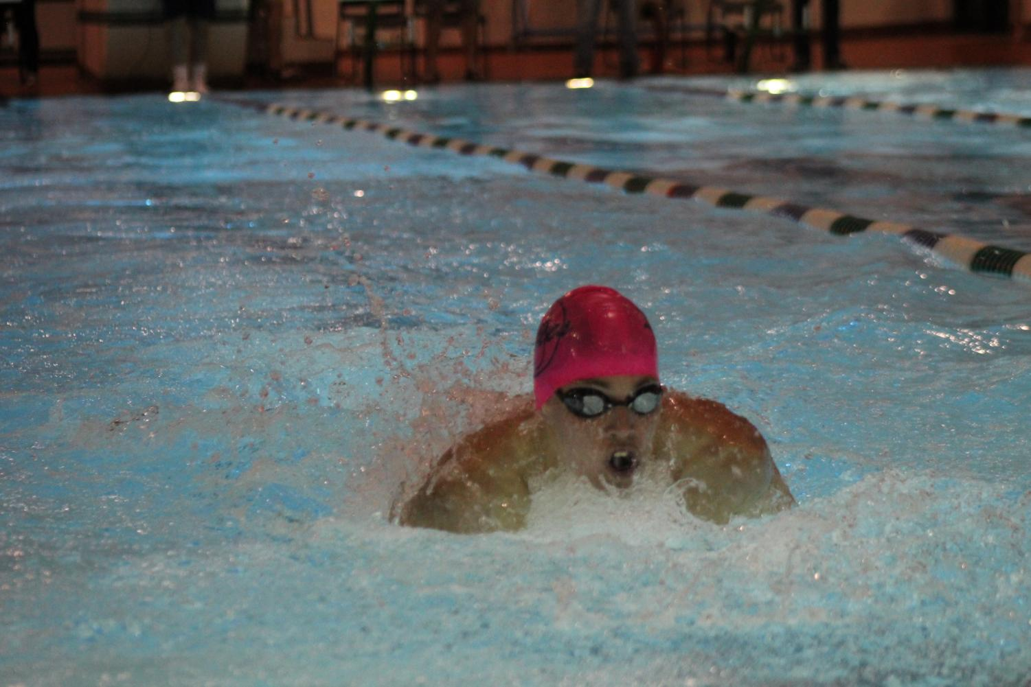 Junior Ethan Comeyne swims the butterfly stroke in a meet on Jan 3. at the Princess Anne Recreation  Center.
