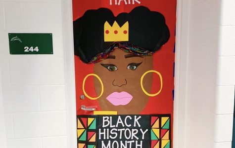 Señora Rosado's door, 244, was decorated by the Black Student Union to represent the importance of the natural hair movement in black culture. Photo taken  on Feb. 10.