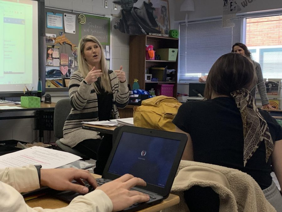 Administrative assistant Lindsey Comfort explaining the idea behind the 'Ride the WAVE' movement to Fara Wiles' 3B Journalism class.