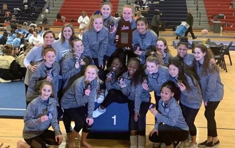 The gymnastics team is awarded medals after their state title win at Patriot High School on Feb. 21.