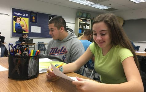 Students Kelly McCarty and Elijah Torres study budgeting vocab terms in economics and personal finance. Taken Jan. 30, 2020.