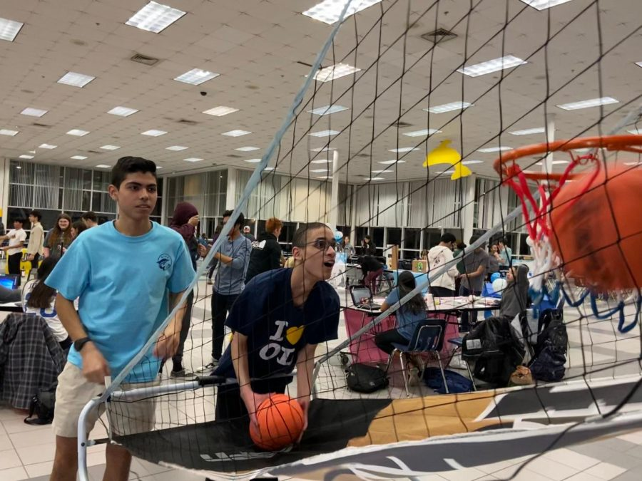 In+the+cafeteria%2C+junior+Alan+Ledezma+and+senior+Angelo+Shaw+shoot+hoops+to+celebrate+a+good+cause.%0A%0A