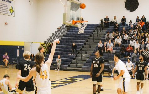 Finn Copen , No. 42, makes a shot during varsity senior night on Feb. 6.