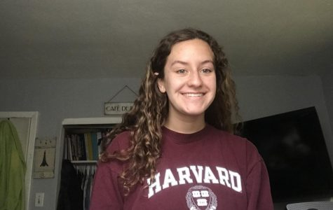 Sophomore Celyna Kemp takes a photo in her Harvard University gear for Future Friday on March 27.