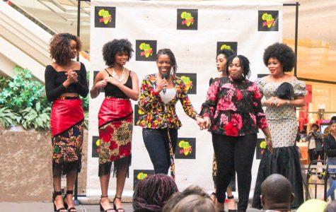 TACA Founder Rita Cohen, Bertha Lawani; creator of Aronse-Amade, and models Tammara Taylor, Amenze Kingsley and Rita Ogundare stand on stage at MacArthur Mall Feb. 29, 2020.