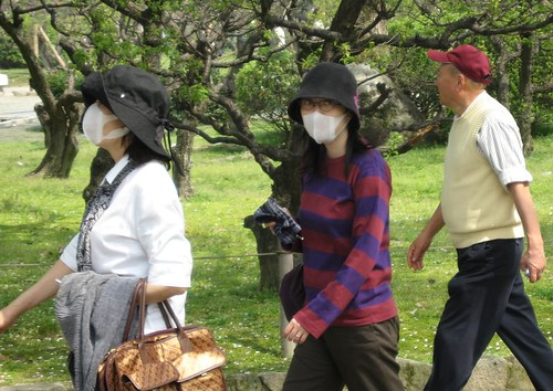 Individuals in Japan travel wearing masks to prevent the spread of illness. Photo sourced from Creative Commons.