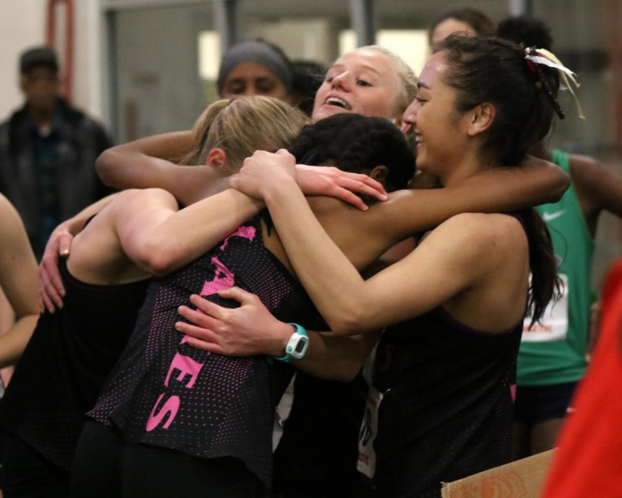 Aniya Mosley, Austin Heft, Meredith King, and Bella Gesick celebrate their newly-won state title in the 4x800 relay after Aniya's last leg. Photo taken on Feb. 28.