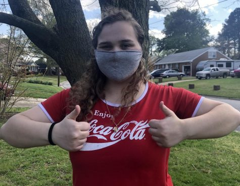 Senior Autumn Williams models her homemade face mask  in her neighborhood on April 6.
