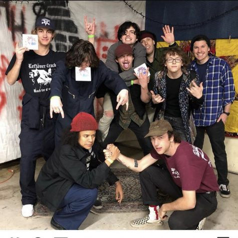 "(From left to right) Lead guitarist Adam Allen, rhythm guitarist Brian Griffin, and vocals Kai Perry celebrate with local bands ""Alpha,"" ""Squid?,"" and ""You're Jovian"" after their show at The Hurt House on March 6."