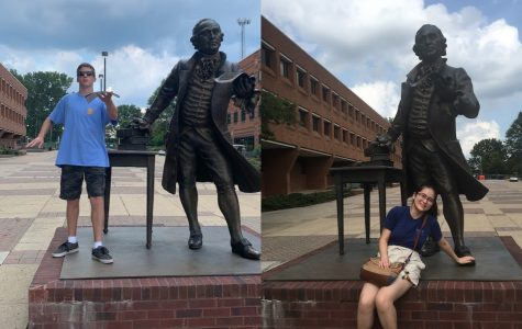After taking a tour of GMU, seniors Ben Majors (left) and Mariko Hart (right) pose with the campus' George Mason statue.