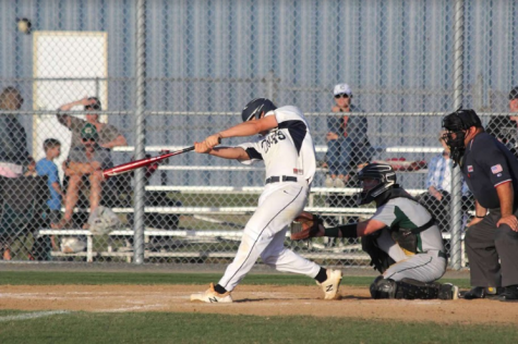 Jonny Wall in full swing, at-bat against Cox High School on May 9, 2019.
