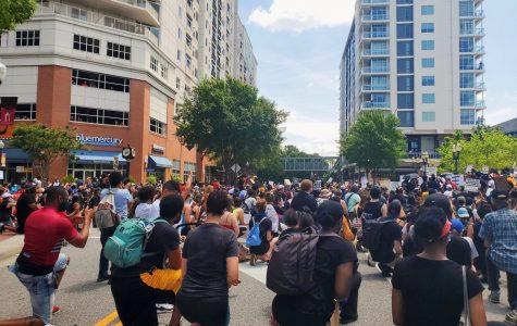 Protestors kneel peacefully in rememberance of George Floyd at Town Center of Virginia Beach on June 6.