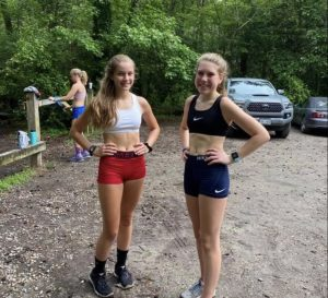 Sophia Pommerenk and Maggie Furco pose while completing their virtual workout in Seashore State Park.