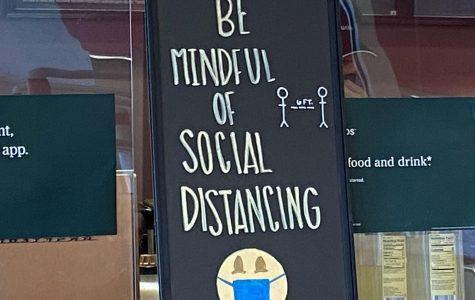 Reminder to follow social distancing rules in Starbucks.