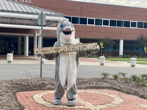 Dolphin mascot welcomes new students in a drive-by orientation in the school