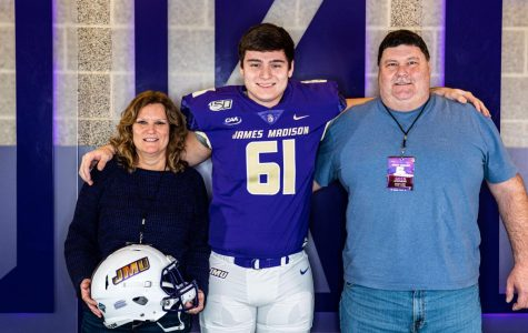 JMU Freshman Tyler Stephens poses with his parents Kathy and Greg Stephens upon his arrival to the university.
